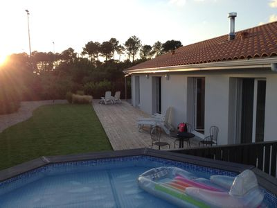 Photo for Beautiful modern house with hot tub and pool in quiet cul de sac close to lake.