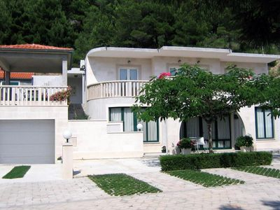Photo for Two bedroom apartment with terrace and sea view Brela, Makarska (A-6056-d)