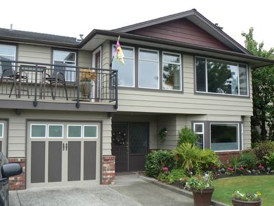 Single family home in quiet residential area,manicured gardens front and back
