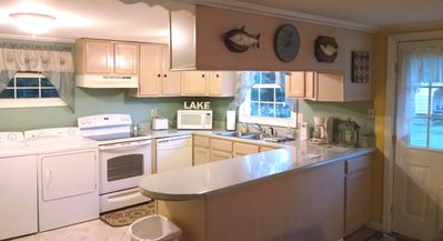 Fully stocked kitchen with washer/dryer