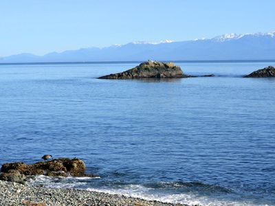 Photo for Right on the beach looking over Juan de Fuca straits