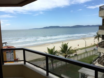 Photo for Front to the sea, beautiful view. 2 qts (suite), air cond, churrasq, WiFi, gar. KK 303.
