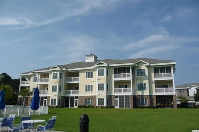 Top End Unit (on right); View from Grill / Pool / Lawn Area.