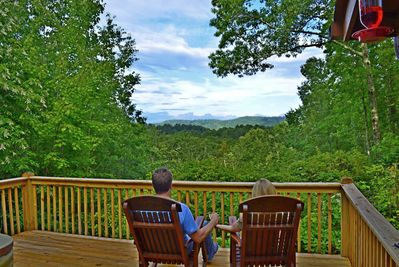 Relax and enjoy the sites and sounds of nature and a framed mountain view!