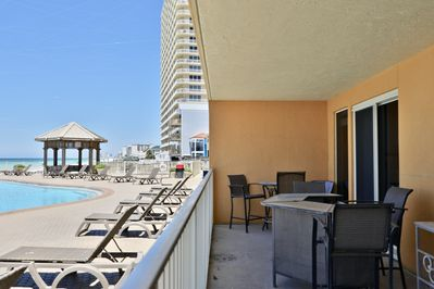 Private balcony opens up to the pool deck!