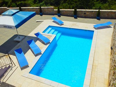 Photo for This 3-bedroom villa for up to 7 guests is located in Pula and has a private swimming pool, air-cond