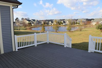 Large, trex style deck with pond and fountain views