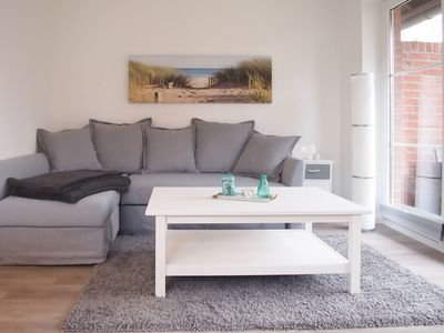 Photo for Modern, high quality apartment for 2-4 pers. with terrace only 3 minutes to the Baltic Sea, 2 bikes included, seasonal beach basket included, WiFi, parking space