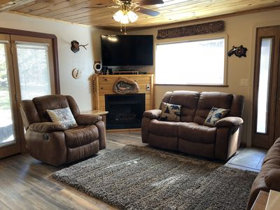 """Living room with gas fire place, 50"""" LED smart TV, DVD player, satellite tv and Wi-Fi. All chairs recline."""
