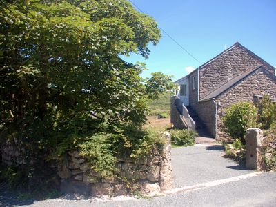 Photo for Peaceful coastal property with large garden. Unbeatable views of  sea and moors.