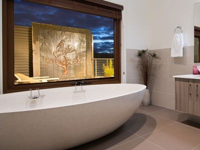 Luxurious stone bath and water feature at dusk