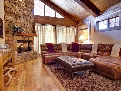 The lofted ceiling and enormous gas fireplace set the tone the moment you enter