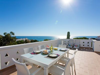 Photo for Spectacular Sea Views & Private Roof Terrace, 2 min walk to Oura Beach EO-2E