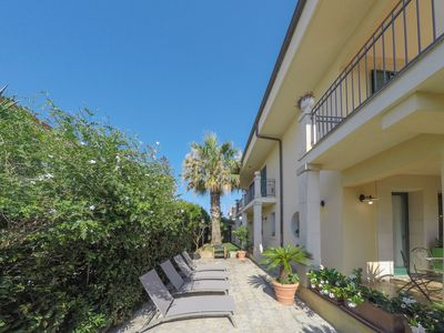 Photo for Elegant villa just a few meters from the beach