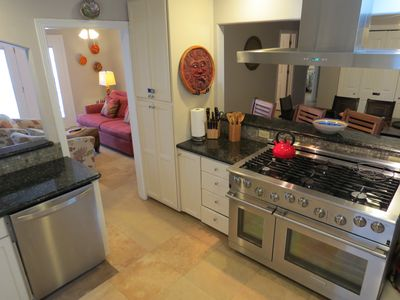 Fully equipped kitchen has upper end stainless appliances.