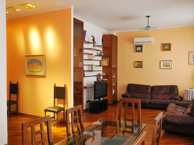 Photo for In the historical center: bright penthouse with large furnished terrace.