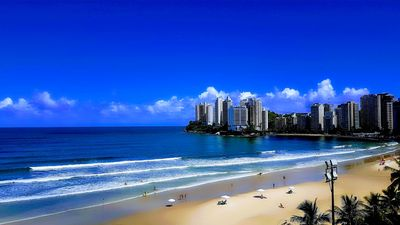 Photo for Apt in Guarujá, facing the sea, beach service, wi-fi, air conditioning, garage