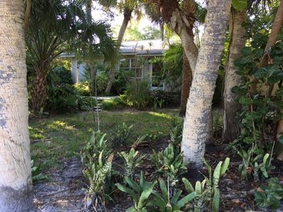 Photo for Lagoon view home with screened pool close to the beach
