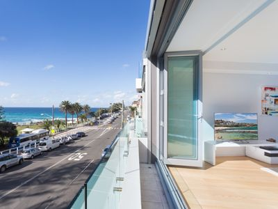 Photo for Directly across from the famous waves of Bronte beach with unobstructed views