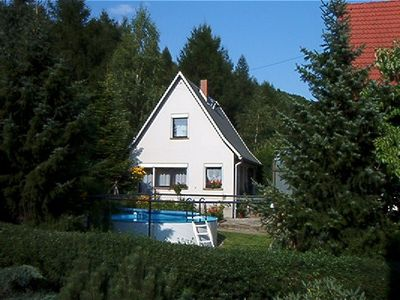 Photo for Cozy vacation home with an outdoor pool in a peaceful location by the forest