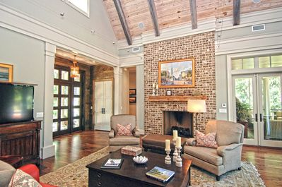 Enjoy the flat screen TV.  French doors lead to the screened in porch.