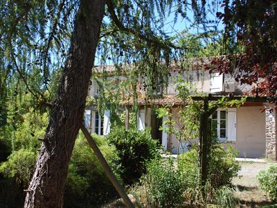 Photo for Spacious sunny three bedroomed gite with covered heated pool and river.