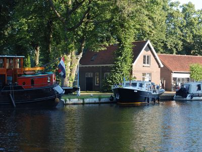 Photo for A wonderful former worker's residence by the water at Dwingeloo