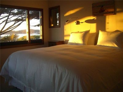 King-size bed that allows you to hear the waves and watch the sunset.