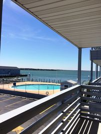 Only 2-3 Night Stay Minimum!  Balcony Overlooks Bay & Pool-  Walk to Beach!!