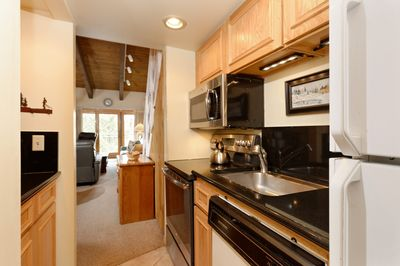 Full galley kitchen with full size appliances.