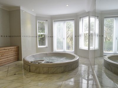 Photo for Garden Apartment with Hot Tub and Sauna