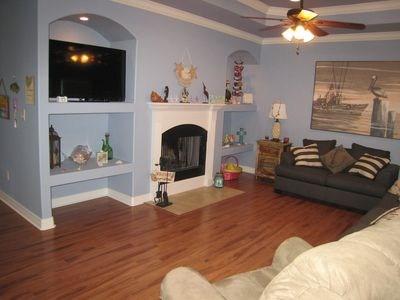 Comfortable livingroom with big screen TV, fireplace and full size sofa bed.