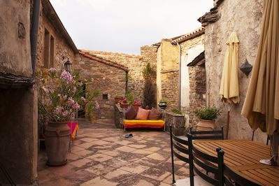 Private Courtyard and terrace. Table for 12. Fireplace to the left  for pleasure