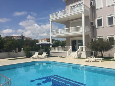 Photo for Poolside Ground Floor 5 mins to beach, prestigious golf resort free wifi