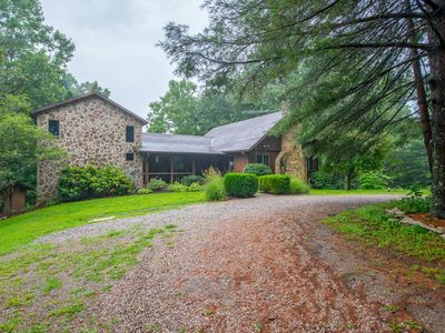 Photo for Old meets new in this unique cabin/timber frame home! 20+ acres bordering State Forest!