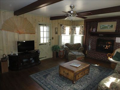 The family room with a gas fireplace, t.v, lots of movies and comfortable couch.