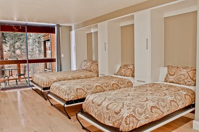 1 queen and 2 twin fold out Murphy beds.