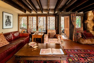 The cosy downstairs lounge area and door to the northern courtyard corridor.