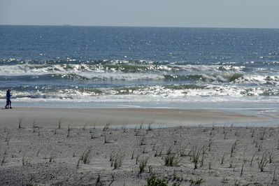 close up picture of ocean from balcony with new little sea oats planted 2017