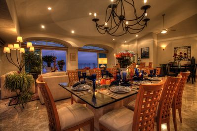 The dining room table easily accommodates 10-12 people