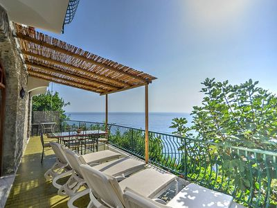 Photo for Villa Lauretta: A characteristic two-story villa set into the cliff, sheer above the sea.