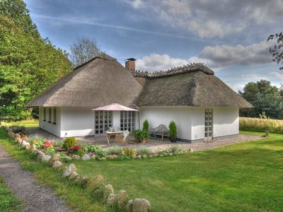 Photo for Unique, modern thatched roof house in a secluded location with a picturesque garden