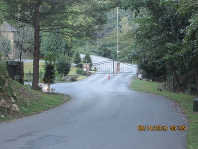 Streetscape view looking at roads near entrance of resort, leading to cabin