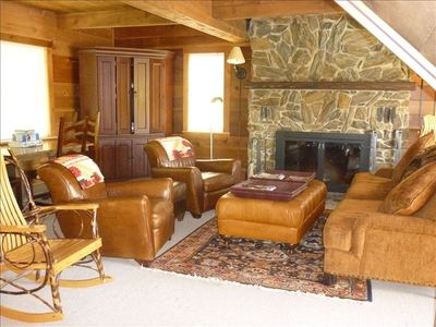 living room with tv and huge fireplace of Ali Vogts house . owner on facebook.