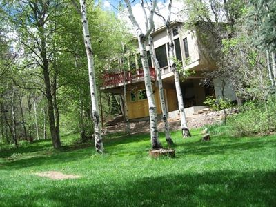 Front view of cabin with lower entry and balcony