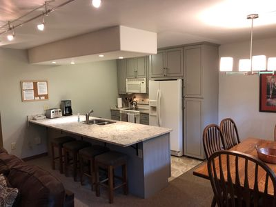 Spacious kitchen, granite counter with plenty of seating options.