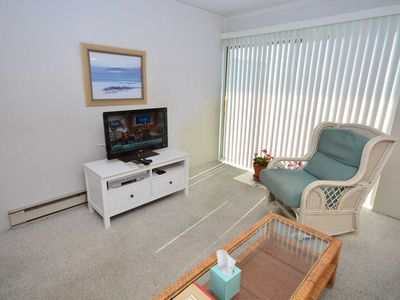 Photo for Simple, care-free 1-bedroom condo with WiFi, partial ocean and bay views, and an outdoor pool located uptown and only a half a block to the beach!