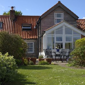 Photo for 2 bedroom cottage on Holy Island with spacious walled garden and sea views