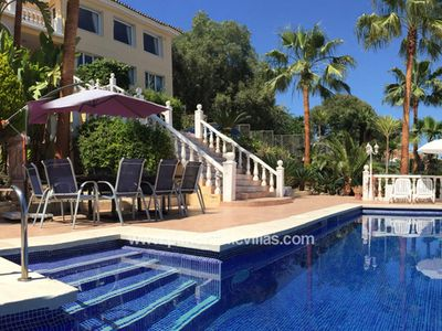 Photo for 8 bedroom Villa, sleeps 15 with Air Con, FREE WiFi and Walk to Beach & Shops