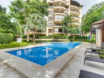 Photo for Modern condo w/ shared pool, entertainment & more - walk to the beach!